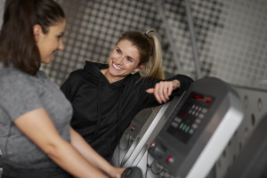 Fitness instructor and woman having a chat